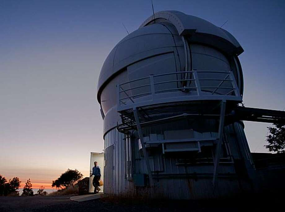 In this file photo an astronomer exits the Automated Planet Finder (APF) facility as the sun sets at the Lick Observatory on Mount Hamilton on Wednesday, August 4, 2010 in San Jose, Calif. Photo: John Sebastian Russo, The Chronicle
