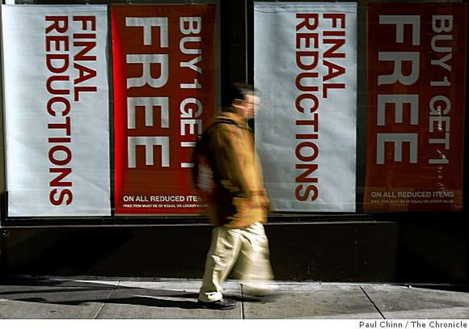 A man walks past the H&M department store on Powell Street in San Francisco, Calif., on Friday, Jan. 9, 2009. Downtown retailers continue to offer deep discounts on their post-Christmas inventory. Photo: Paul Chinn, The Chronicle