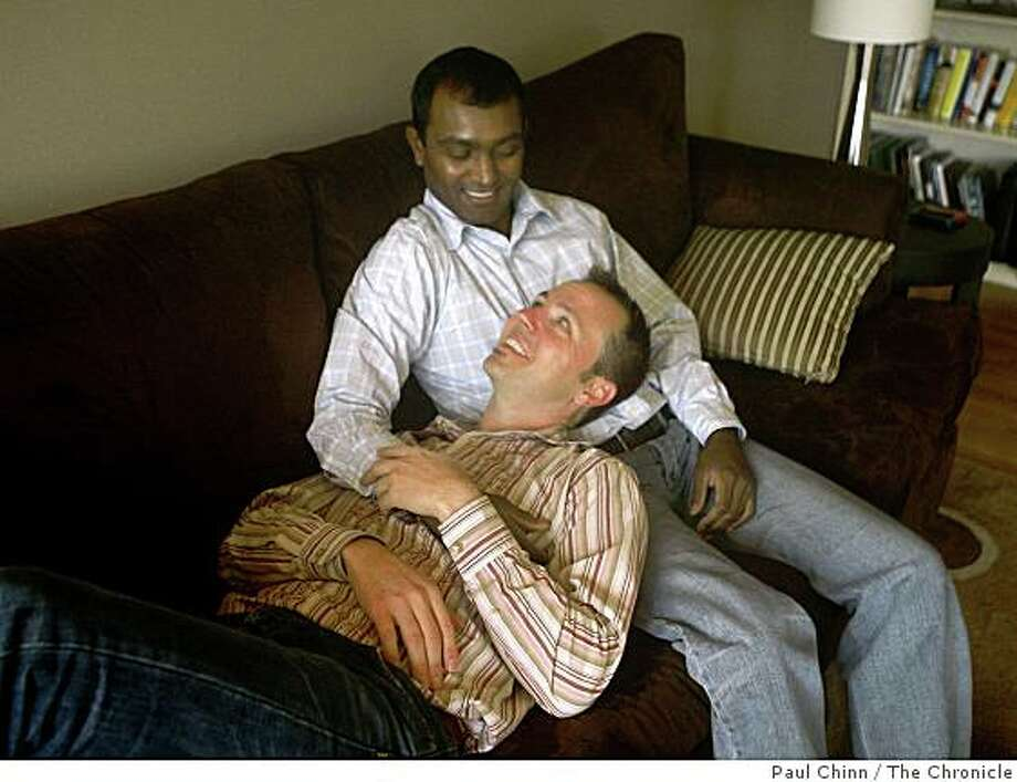 Satish Viswanatham, top, and Jeff Hauk relax on the couch at their home in San Francisco, Calif., on Tuesday, Dec. 16, 2008. Photo: Paul Chinn, The Chronicle