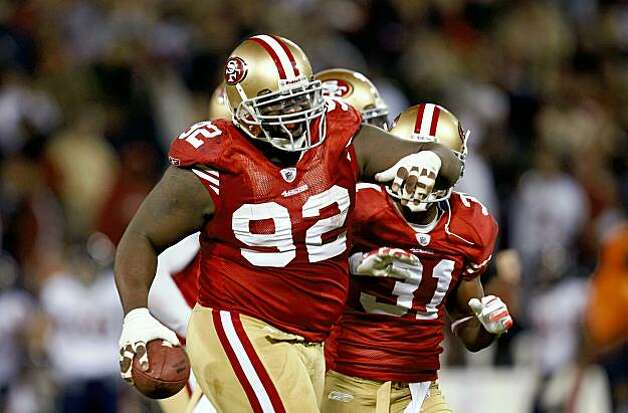 San Francisco 49ers defensive tackle Aubrayo Franklin (92) celebrate his 2nd quarter inteception as the San Francisco 49ers take on the Chicago Bears on Thursday November 12, 2009 in San Francisco, Calif. Photo: Michael Macor, The Chronicle