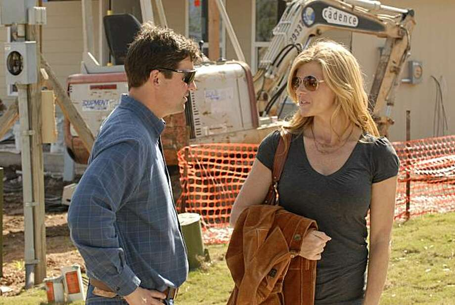 "FRIDAY NIGHT LIGHTS -- ""The Lights in Carroll Park"" Episode 409 -- Pictured: (l-r) Kyle Chandler as Coach Eric Taylor, Connie Britton as Tami Taylor. Photo: Bill Records, NBC"