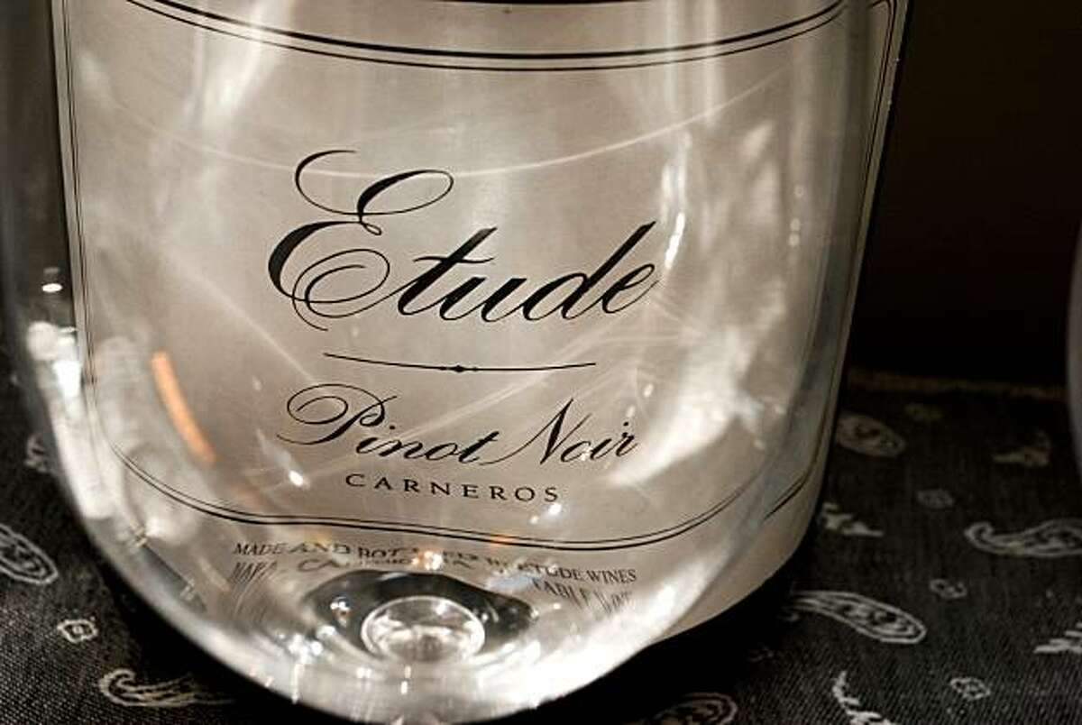 A wine glass catches the light in the tasting room at Etude winery in Napa County, CA Thursday Aug. 12, 2010.