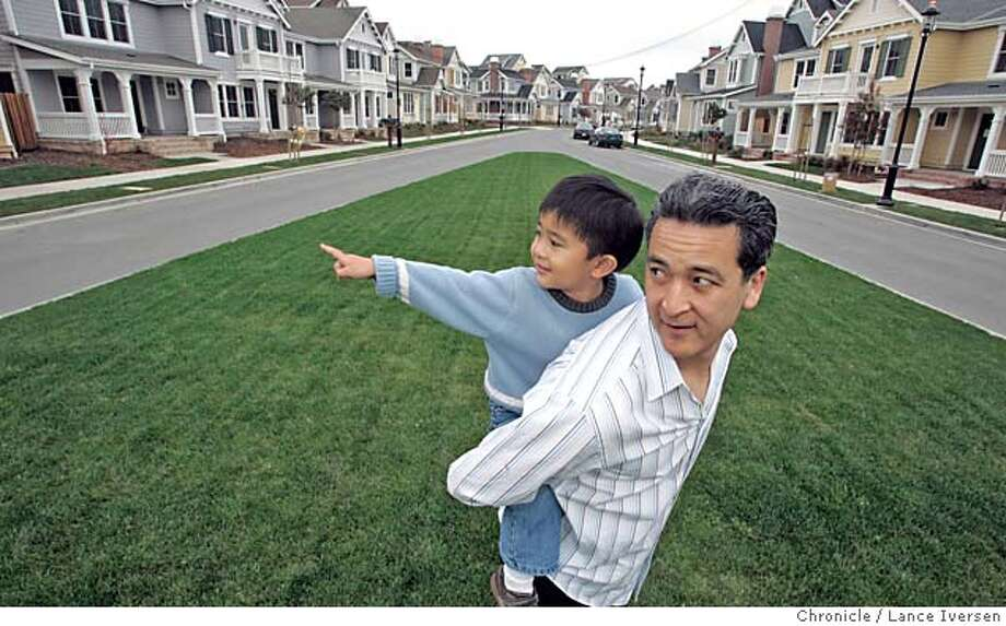 HERCULES_127.jpg_  Patrick Tang and his son Jeremy age 3 play in front of Jeremy's aunts home on Baywood Lane in the Baywood development in Hercules. The Tangs live in a neighboring development called Promenade that has new homes built in Italianate, Victorian and Craftsman design. Hercules is a bastion of what is called the New Urbanism, which emphasizes the importance of distinctive homes and self-sufficient neighborhoods, which is an unusual concept in the suburbs. By Lance Iversen/San Francisco Chronicle Photo: Lance Iversen