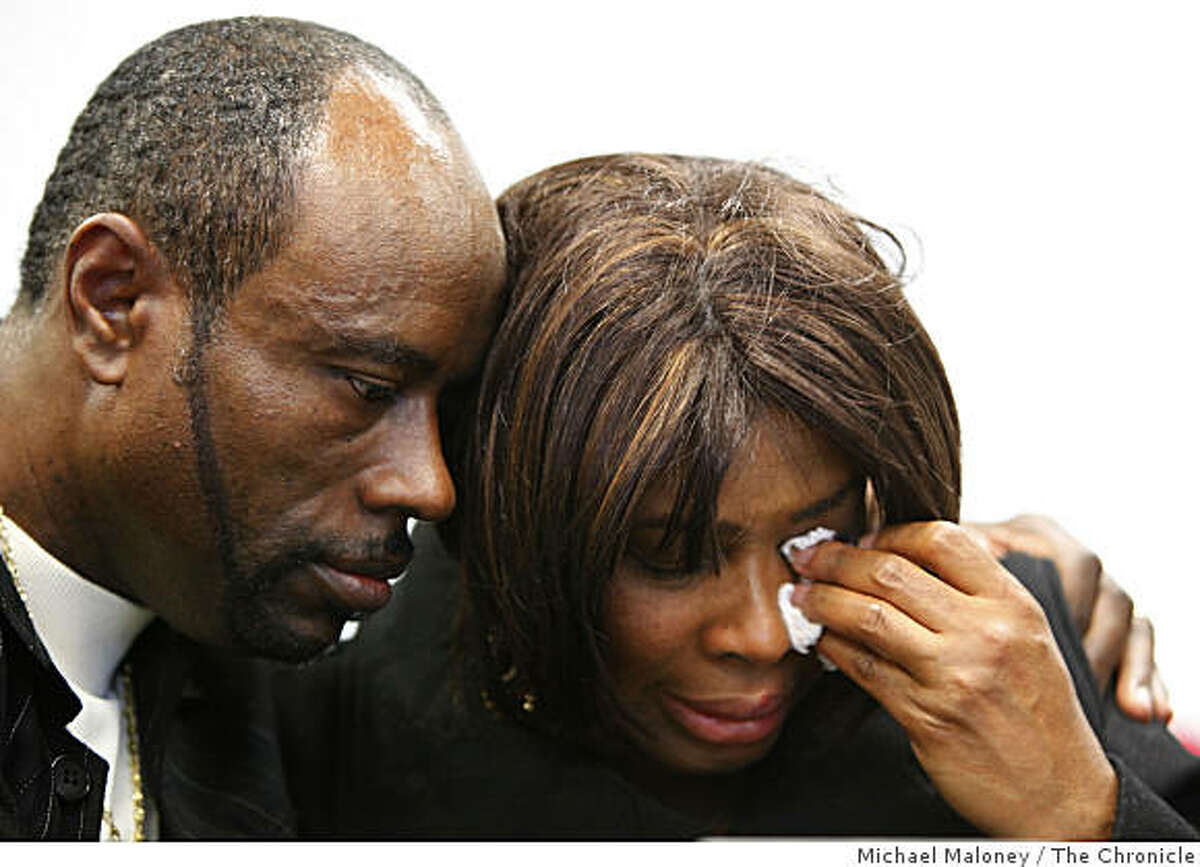 Bobby Johnson (left) comforts his weeping sister, Wanda Johnson as attorney John Burris describes the shooting of Oscar Grant slain by a BART police officer on New Year's Day. The press conference was held near Burris' office in Oakland, Calif. on January 4, 2009.