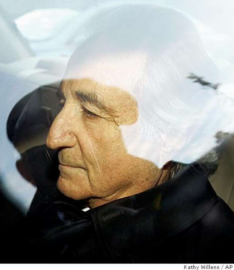 **FILE** In this Jan. 5, 2009 file photo, disgraced financier Bernard Madoff leaves U.S. District Court in Manhattan after a bail hearing in New York. (AP Photo/Kathy Willens, File) Photo: Kathy Willens, AP