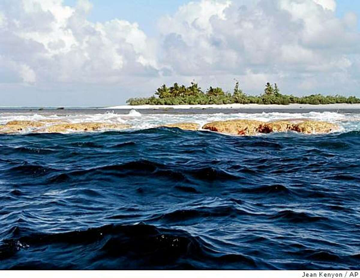 In this photo released by NOAA, Rose Island, seen here from outside the atoll rim, is one of two small islands within the lagoon of Rose Atoll in America Samoa in this photo, date unknown. Parts of three remote and uninhabited Pacific island chains are being set aside by President George W. Bush as national monuments to protect them from oil and gas extraction and commercial fishing in what will be the largest marine conservation effort in history. The three areas _ totaling some 195,280 square miles _ include the Mariana Trench and the waters and corals surrounding three uninhabited islands in the Northern Mariana Islands, Rose Atoll in American Samoa and seven islands strung along the equator in the central Pacific Ocean. (AP Photo/NOAA, Jean Kenyon)