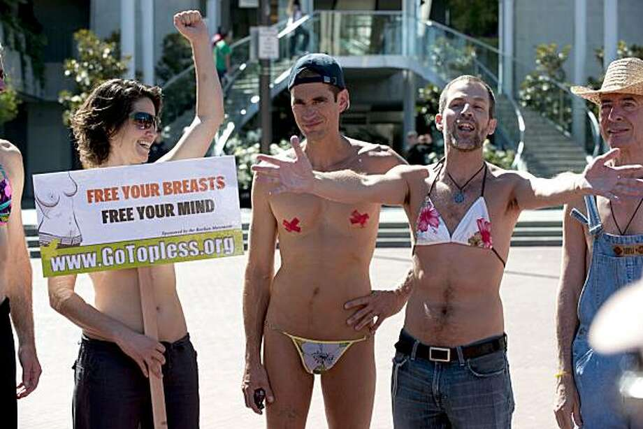 "From left, Luna Baron, Lloyd Fishback and Logan Starman address the group of protesters congregating for ""National Go-Topless Day"" near Justin Herman Plaza in San Francisco on Sunday. Photo: Chad Ziemendorf, The Chronicle"