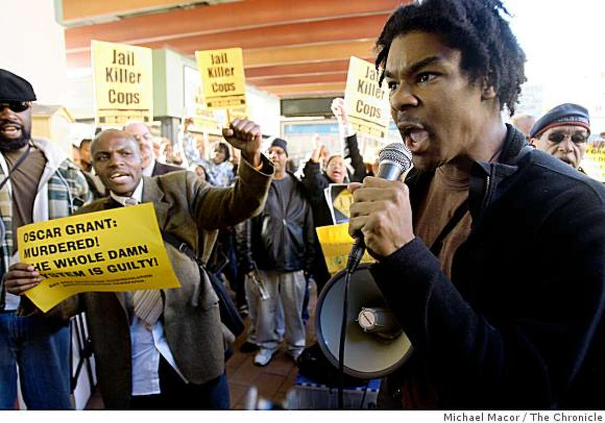 Evan Shamar, of CAPE, Coalition Against Police Executions, organizer of the rally speaks to the hiundreds gathered protesting the shooting death of Oscar Grant, as hundreds gather at the Fruitvale BART station on Wednesday Jan. 7, 2009, in Oakland, Calif.,