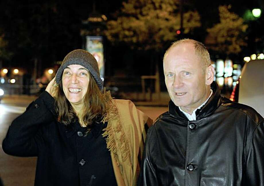"US rock icon Patti Smith (L) speaks with Christophe Girard, Paris deputy-mayor in charge of culture, organizer of the Paris ""Nuit blanche"" (White Night) late on October 03, 2008, on the eve of the 7th edition of this cultural event. Smith will perform this evening at the Latin Quarter church of Saint Germain des Pres for a music and text performance with her children. The French capital stages its annual round-the-clock festival, expected to draw at least a million people into the streets to enjoy dusk-til-dawn access to music and modern art venues across the capital. Photo: Boris Horvat, AFP/Getty Images"