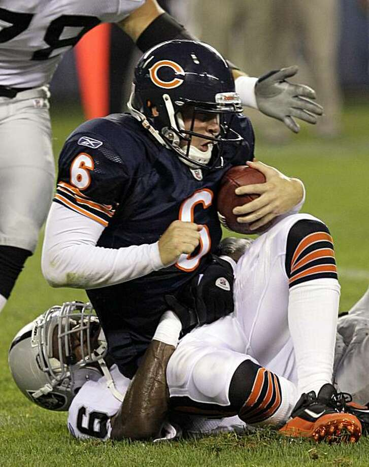 Chicago Bears quarterback Jay Cutler (6) is sacked Oakland Raiders linebacker Kamerion Wimbley, bottom, in the first half of a preseason NFL football game in Chicago, Saturday, Aug. 21, 2010. Photo: Charles Rex Arbogast, AP
