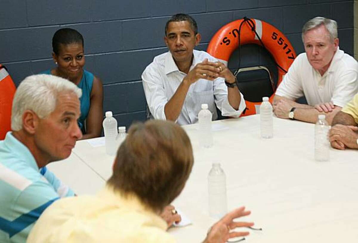 PANAMA CITY, FL - AUGUST 14: (AFP OUT) (Counter clockwise) Panama City Mayor Scott Clemes and Florida Gov. Charlie Christ speak with first lady Michelle Obama, United States President Barack Obama, and Secretary of the Navy Ray Mabus during a meeting with area officials at a Coast Guard base August 14, 2010 in Panama City, Florida. The First Family is visiting the area to help promote tourism and check up on cleanup efforts from the aftermath of the Deepwater Horizon Oil spill.