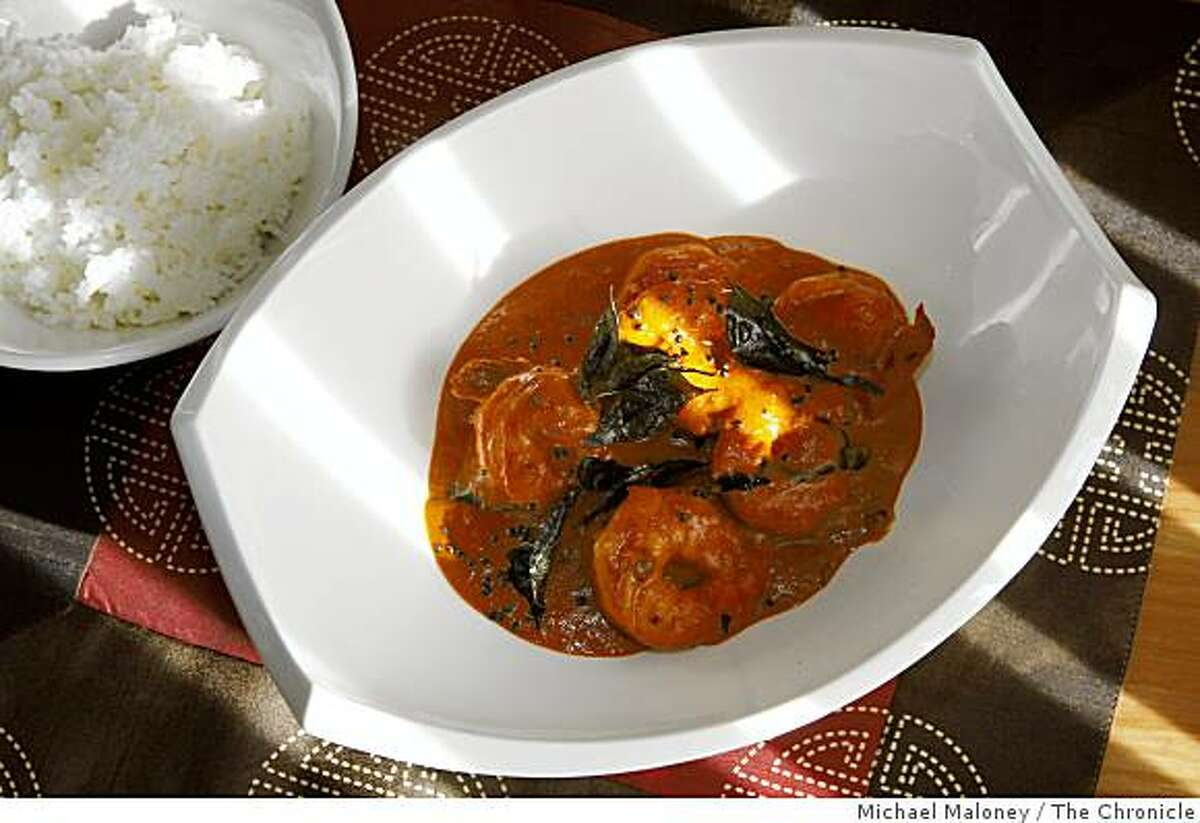 Coconut shrimp curry and steamed rice prepared by Amber India corporate chef Vittal Shetty.