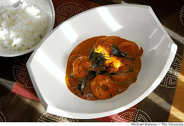 Coconut shrimp curry and steamed rice prepared by Amber India corporate chef Vittal Shetty. Photo: Michael Maloney, The Chronicle