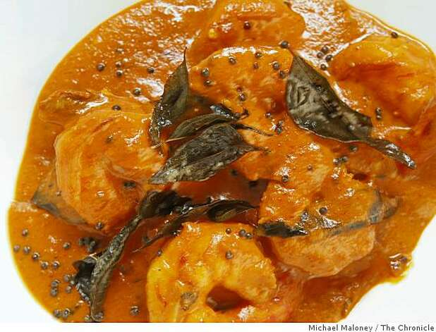 Coconut shrimp curry prepared by Amber India corporate chef Vittal Shetty. Photo: Michael Maloney, The Chronicle