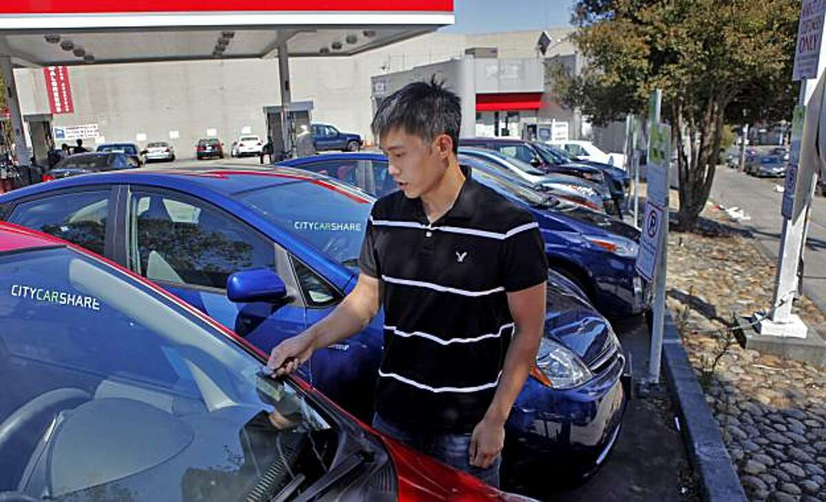 Nathaniel Lee uses an automatic lock to unlock the car as he checks out a car from the carshare program, Monday August 16, 2010, along Market and 15th street, in San Francisco, Calif. He has been using carshare for two years.