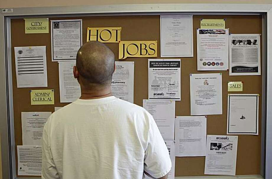 A job seeker checks for new jobs postings at the Glendale Workforce Services Center Thursday, Aug. 19, 2010, in Glendale, Calif. Employers appear to be laying off workers again as the economic recovery weakens. The number of people applying for unemployment benefits reached the half-million mark last week for the first time since November. Photo: Damian Dovarganes, AP