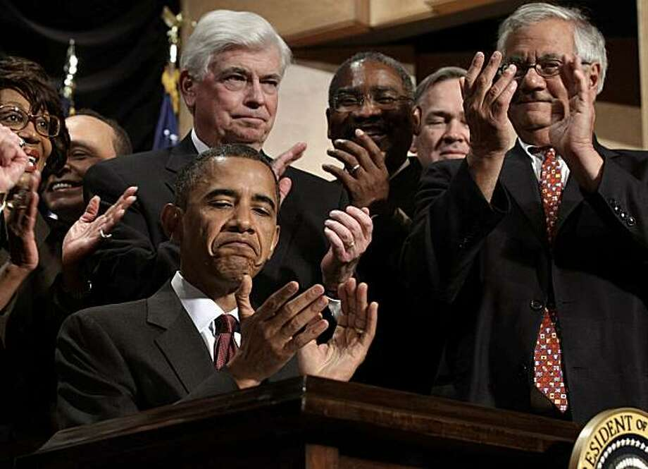 U.S. President Barack Obama applauds after signing the Dodd-Frank Wall Street Reform and Consumer Protection Act during a ceremony at the Ronald Reagan Building and International Trade Center in Washington, D.C., U.S., on Wednesday, July 21, 2010. Looking on are the bill's co-sponsors, Senate Banking Chairman Christopher Dodd, center left, and House Financial Services Chairman Representative Barney Frank, right. Obama signed the most sweeping set of financial rules since the Great Depression today, kicking off an election-year fight to define how the law will be put into effect. Photographer: Chip Somodevilla/Pool via Bloomberg *** Local Caption *** Barack Obama; Barney Frank; Christopher Dodd Photo: Chip Somodevilla, Via Bloomberg