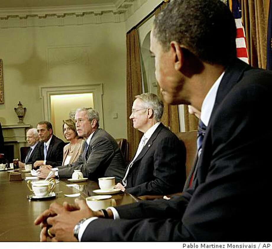 ** ADVANCE FOR SUNDAY, NOV. 2 AND THEREAFTER -- FILE ** In this Sept. 25, 2008 file photo, President Bush, center, meets with Republican presidential candidate Sen. John McCain, R-Ariz., far left, Democratic presidential candidate Sen. Barack Obama, D-Ill., far left, and congressional leaders in the Cabinet Room of the White House in Washington to discuss the proposed bailout of the financial industry. Also seated with them from left to right, Minority Leader John A. Boehner, R-Ohio, Speaker of the House Nancy Pelosi, D-Calif., and Senate Majority Leader Sen. Harry Reid, D-Nev. (AP Photo/Pablo Martinez Monsivais, File) Photo: Pablo Martinez Monsivais, AP