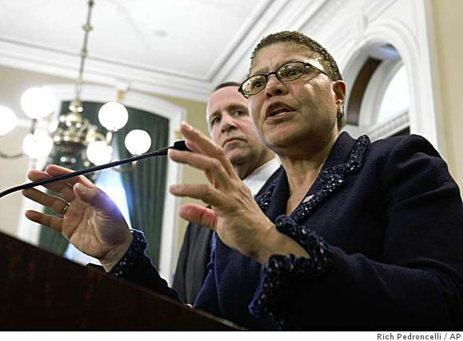 Assembly Speaker Karen Bass, of Los Angeles, answers a question concerning the $18 billion Democratic budget proposal that has been sent to Gov. Arnold Schwarzenegger, during a Capitol news conference held with state Sen. President Pro Tem Darrell Steinberg, of Sacramento,  in Sacramento,  Calif., Tuesday, Jan. 6, 2009. Schwarzenegger has promised to veto the package. (AP Photo/Rich Pedroncelli) Photo: Rich Pedroncelli, AP