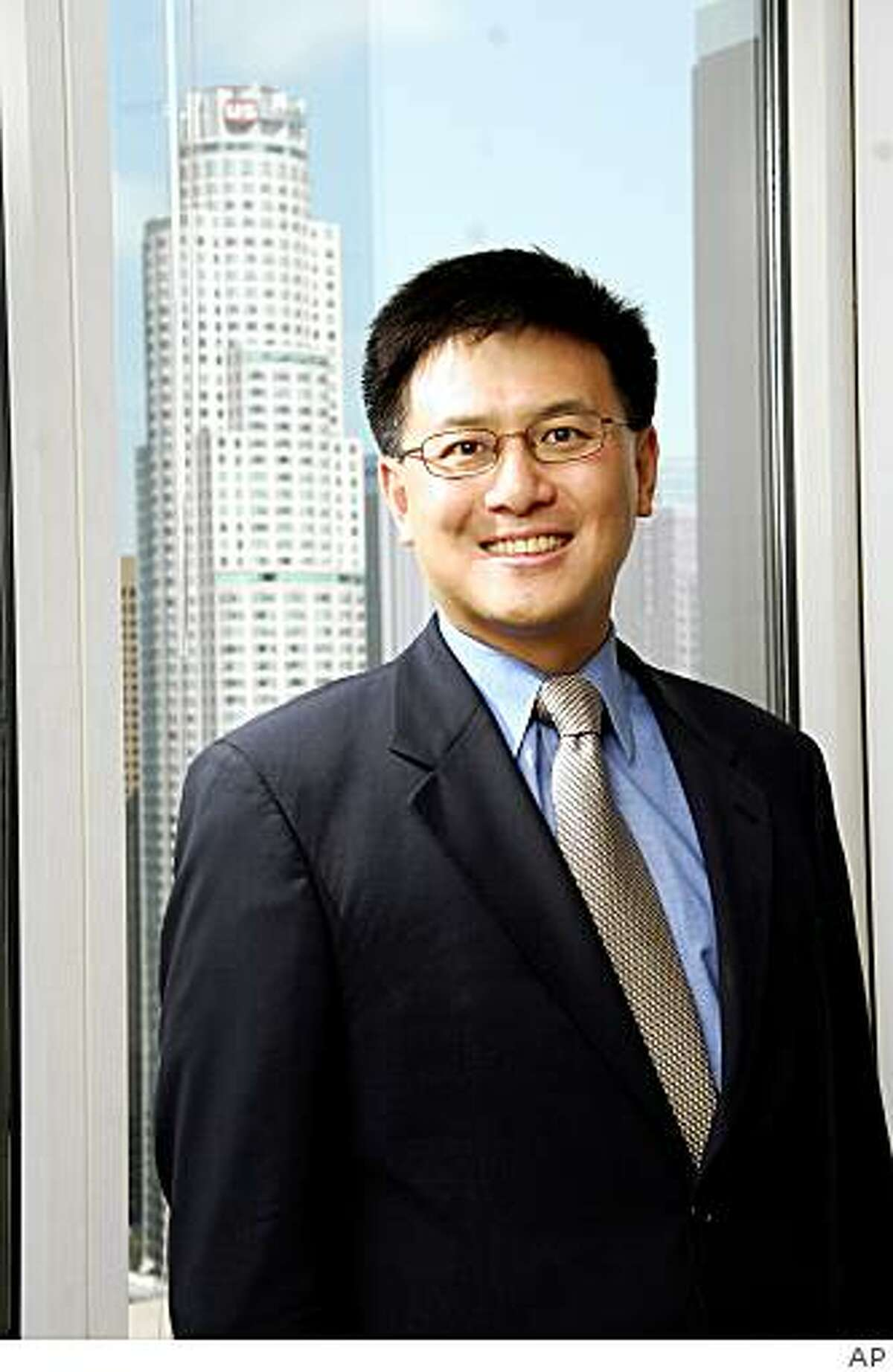 In this undated photo provided by the John Chiang For State Controller campaign, shown is Board of Equalization member John Chiang.