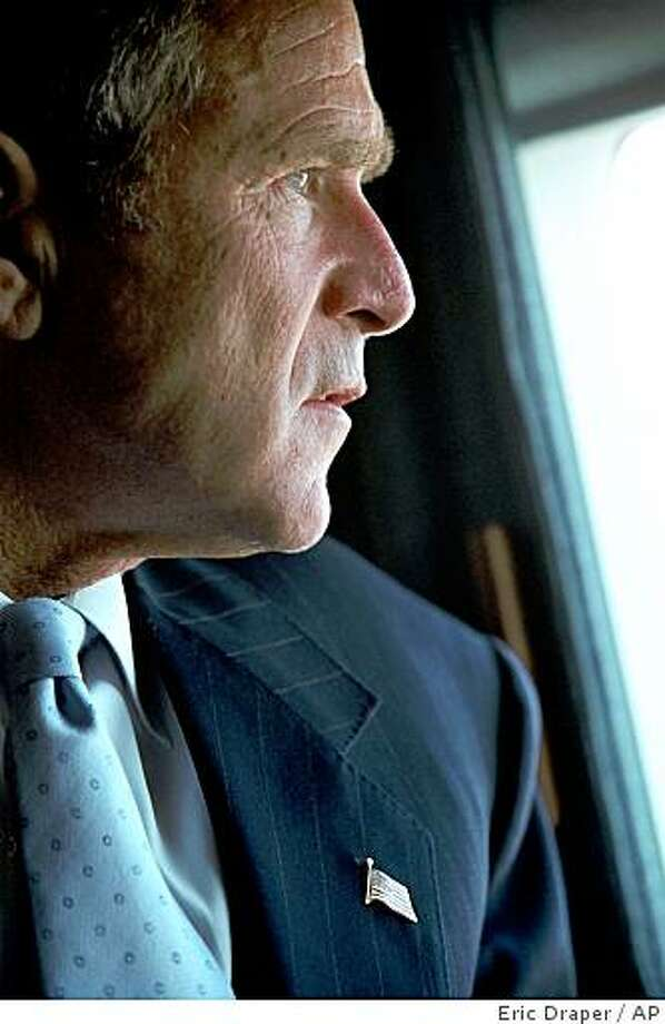 President Bush looks at the Pentagon in Washington from Marine One on his way to New York, Friday, Sept. 14, 2001. Bush faces one of the most complicated national security challenges ever to confront a U.S. president in the wake of Tuesday's terrorist attacks on the Pentagon and the World Trade Center towers in New York. Photo: Eric Draper, AP