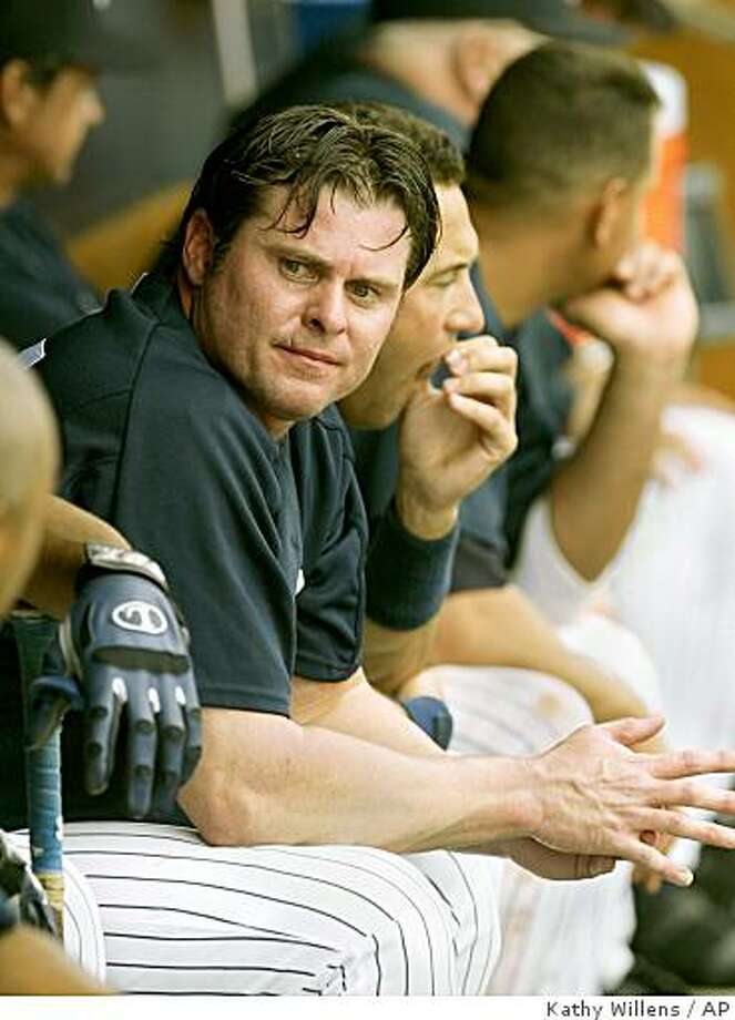 New York Yankees designated hitter Jason Giambi sits on the bench with teammates during the Yankees game against the Florida Marlins, Tuesday, March 15, 2005, at Legends Field in Tampa, Fla. Giambi may find out Tuesday whether he will have to testify about steroid usage at Thursday's congressional hearings in Washington D.C. (AP Photo/Kathy Willens) Photo: Kathy Willens, AP