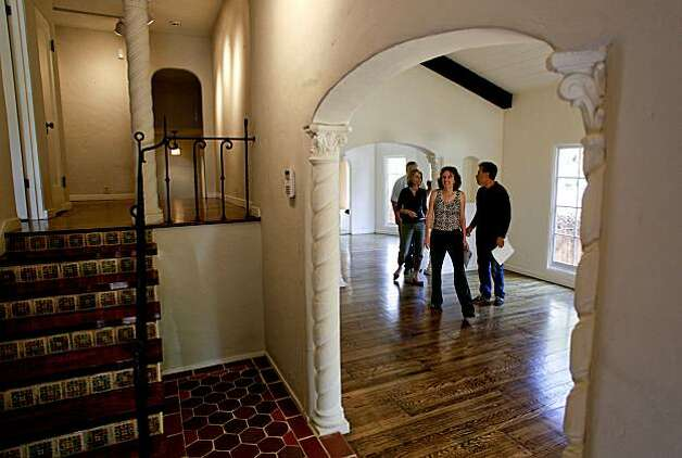 Realtors from the firm Marvin Gardens, in Berkeley tour the bank-owned foreclosed in Berkeley, Calif. on Thursday August 19, 2010, in the Berkeley Hills which is going for an asking price of $899,000 Photo: Michael Macor, The Chronicle