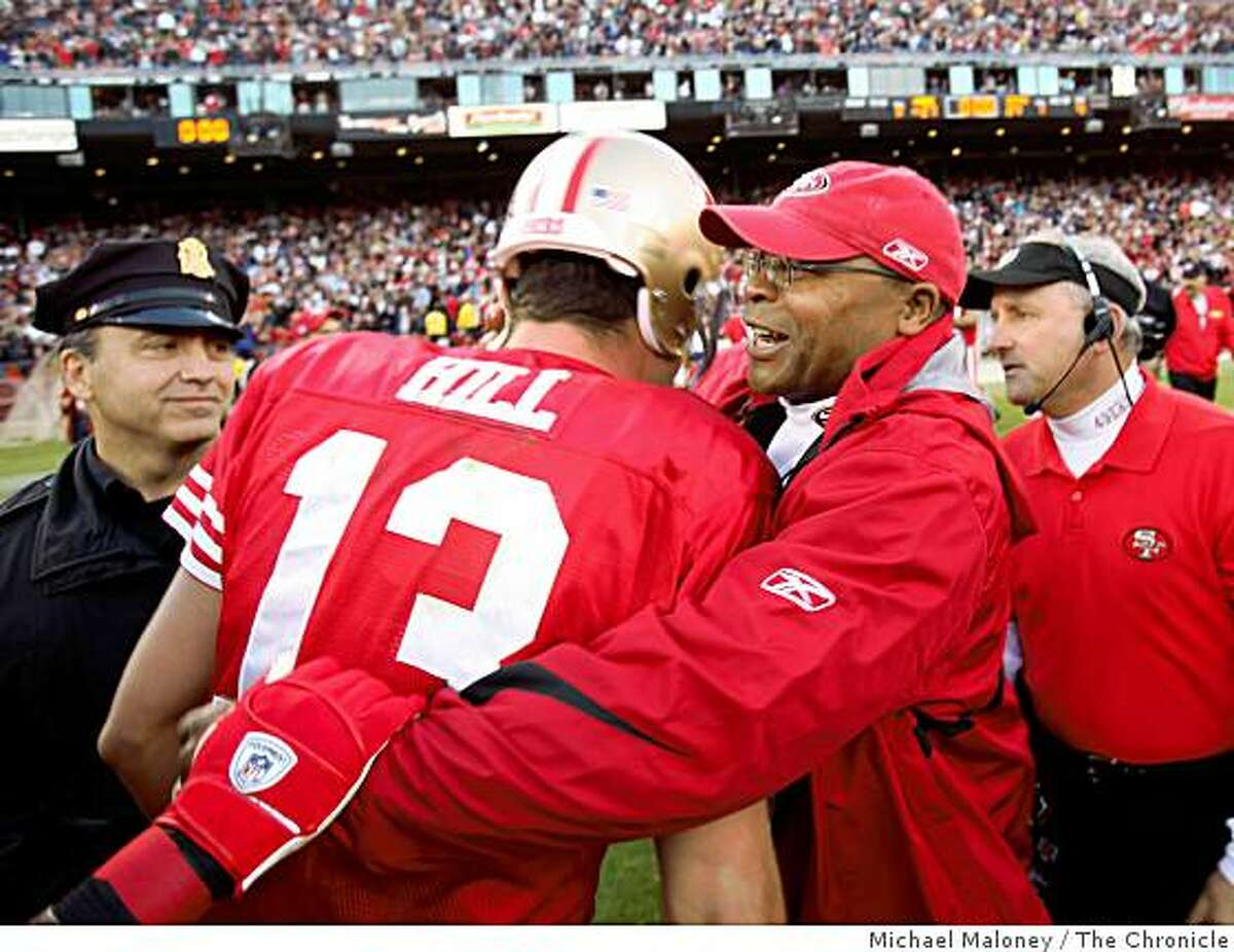 San Francisco 49ers head coach Mike Singletary (right) and quarterback Shaun Hill (13) meet after winning 27-24 during a game hosted by the 49ers at Candlestick Park on Sunday, December 28, 2008.