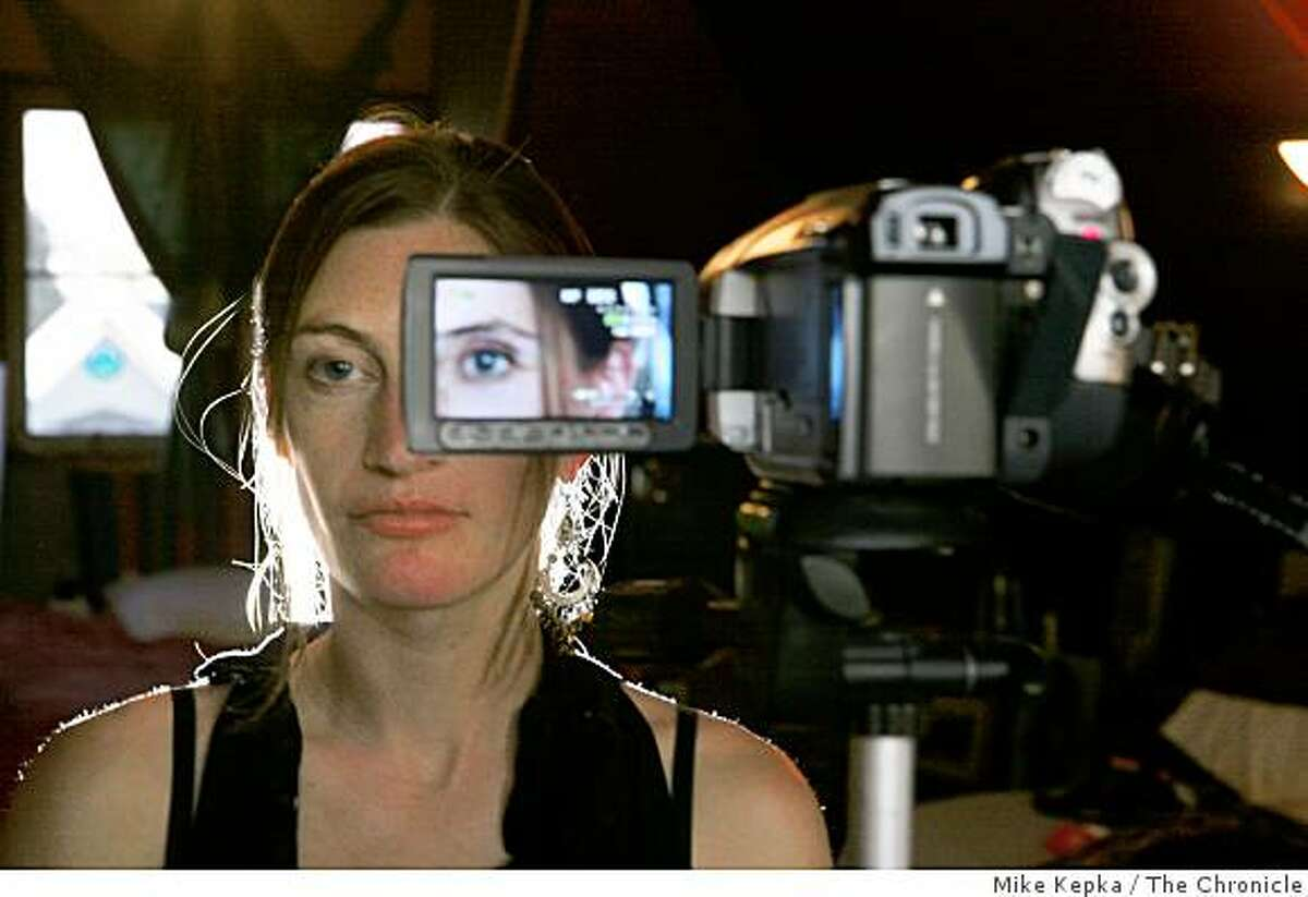 Tanya Vlach, a San Francisco artist who wants to become the first person to implant a video camera behind her prosthetic eye, poses for a portrait in her home on Thursday Dec. 11, 2008 in San Francisco, Calif.