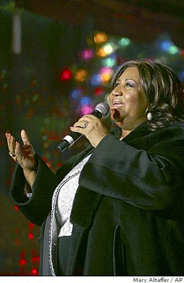 Aretha Franklin performs during the 85th annual Christmas tree lighting at the New York Stock Exchange in New York on Dec. 4, 2008. Photo: Mary Altaffer, AP
