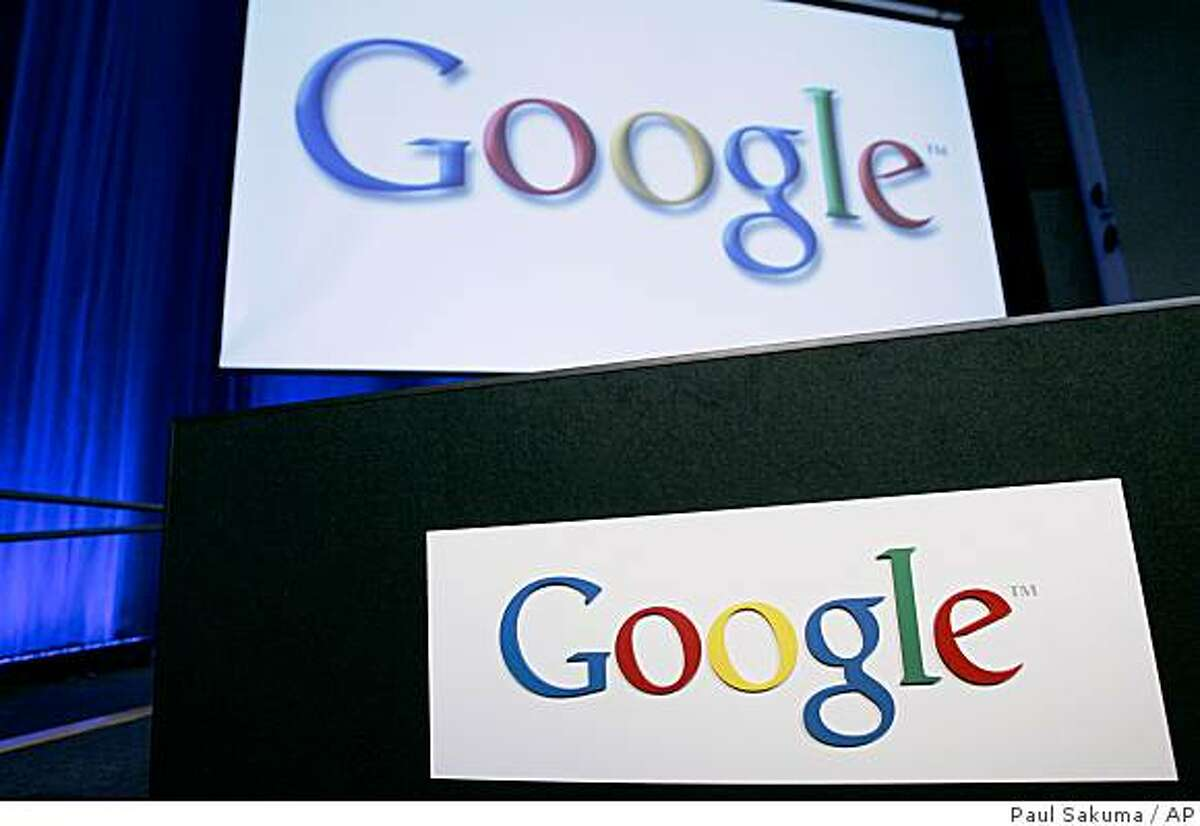 Google signs shown inside Google headquarters in Mountain View, Calif., Monday, Oct. 27, 2008. Google Inc. has scrapped its Internet advertising partnership with struggling rival Yahoo Inc. Wednesday Nov. 5, 2008, abandoning attempts to overcome the objections of antitrust regulators and customers who believed the alliance would give Google too much power over online commerce. (AP Photo/Paul Sakuma)