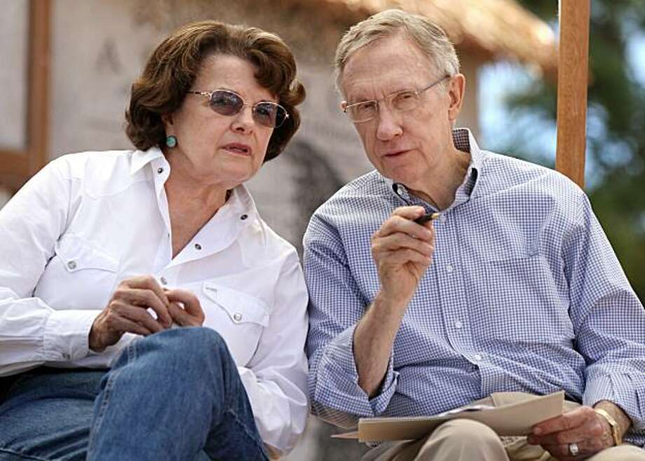 U.S. Sens. Dianne Feinstein and Harry Reid talk during Tuesday's Tahoe Summit, Aug. 17, 2010, at the Sand Harbor State Park near Incline Village, Nev. The annual event focuses on the environmental issues facing Lake Tahoe. Photo: Cathleen Allison, AP
