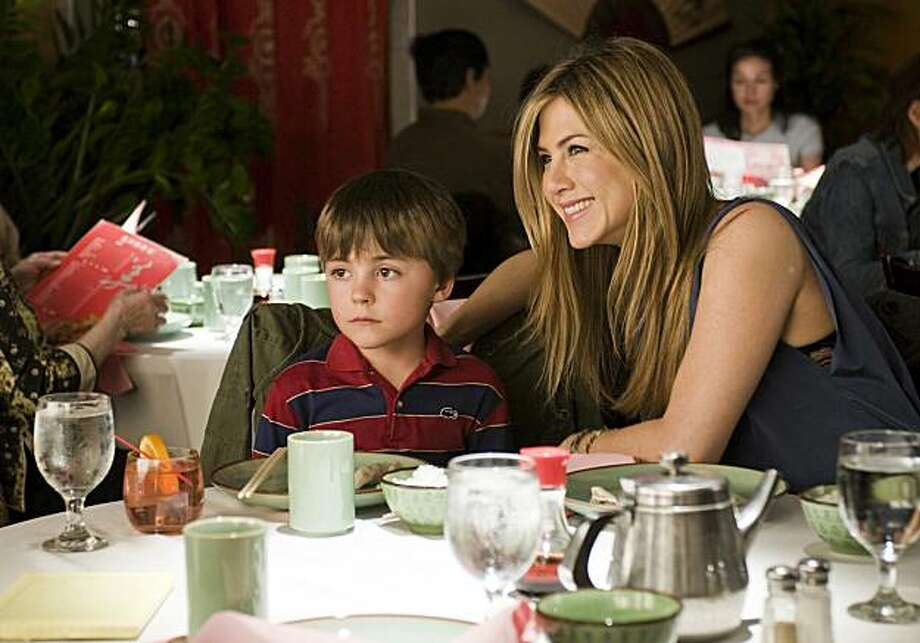 """In this film publicity image released by Miramax Films, Thomas Robinson, left, and Jennifer Aniston are shown in a scene from """"The Switch."""" Photo: Macall Polay, AP"""