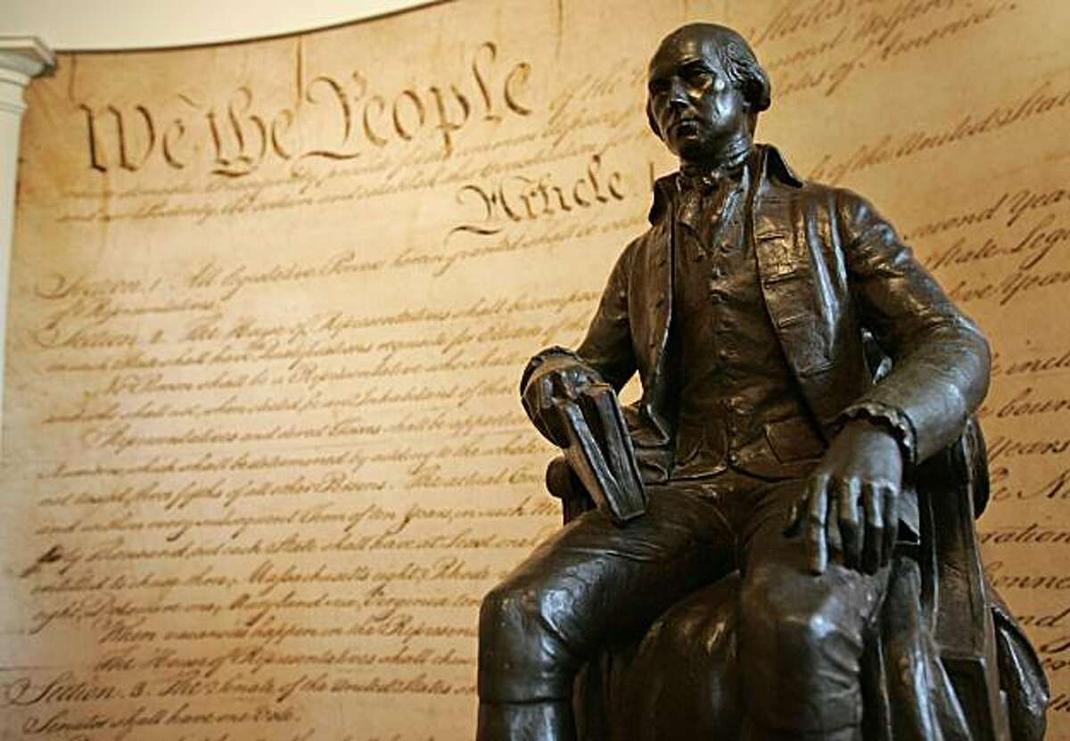 A statue of former President James Madison is shown in front of a mural of the Constitution in the education center at Montpelier, Madison's home, in Orange, Va., Wednesday, Aug. 13, 2008. (AP Photo/Steve Helber)