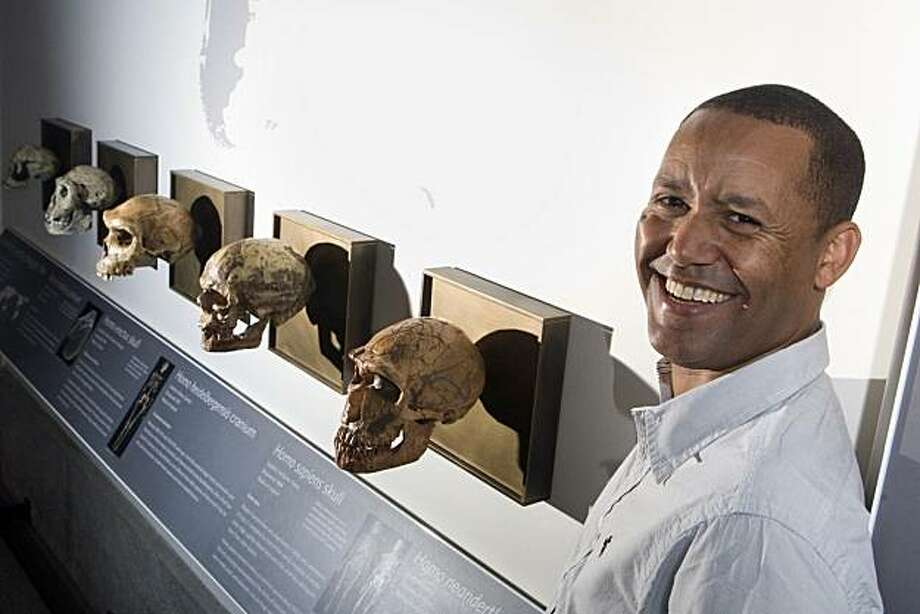 The California Academy of Science's curator of anthropology, Dr. Zeresenay Alemseged, poses for a portrait in the Africa exhibit at the Academy in Golden Gate Park in San Francisco, Calif. on Thursday, August 5, 2010.  Alemseged has discovered evidence indicating pre-humans used tools to eat meat 3.4 million years ago in Ethiopia.   Kat Wade / Special to the Chronicle Photo: Kat Wade, Special To The Chronicle