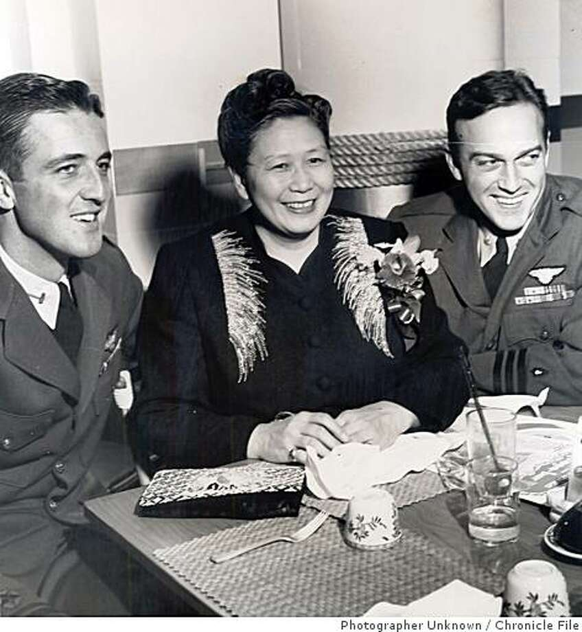 "wayback04.jpg Dec. 12, 1945 - Dr. Margaret Jessie Chung, known as ""Mom"" Chung, with two of her ""adopted"" servicemen. She wrapped and sent thousands of Christmas gifts to servicemen during World War II. She died in 1958.Photographer Unknown/Chronicle File Photo: Photographer Unknown, Chronicle File"