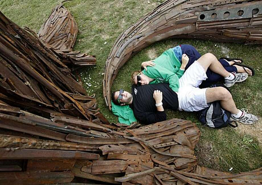Sara Churchill and Ari Kirschenbaum of Washington state rest before the bands begin at Outside Lands in San Francisco's Golden Gate Park on Sunday. Photo: Brant Ward, The Chronicle