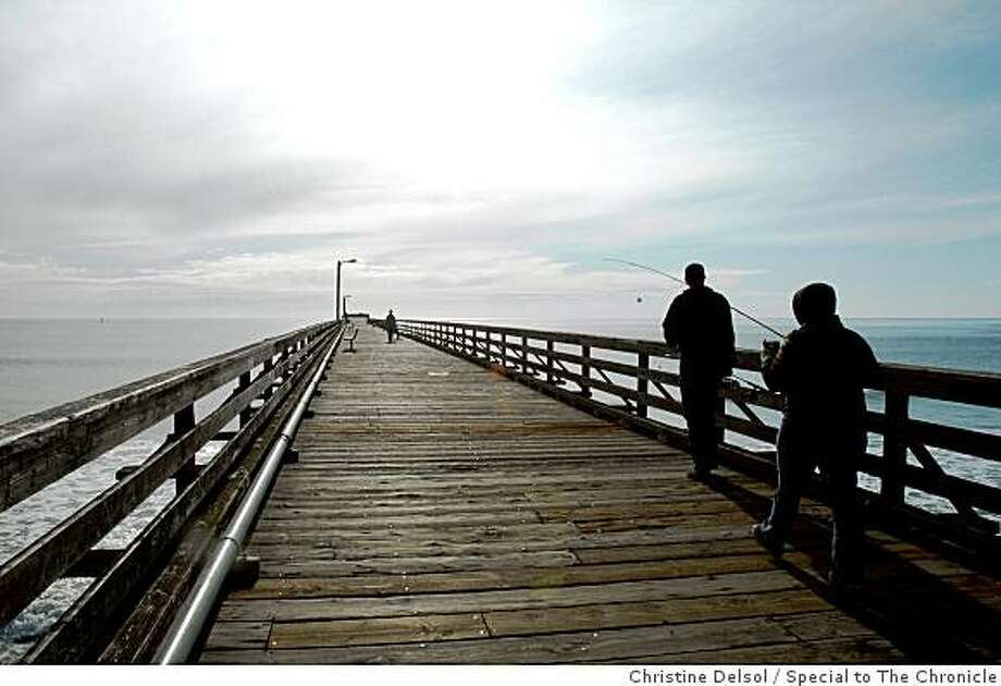 """Cayucos, Calif. -- Cayucos pier stands in the middle of Cayucos State Beach in the center of town. It might not literally be the """"last of the California beach towns,"""" as the unofficial slogan goes, but Cayucos, on the Central Coast between Cambria and Morro Bay, is a California classic. Christine Delsol/Special to The Chronicle Photo: Christine Delsol, Special To The Chronicle"""