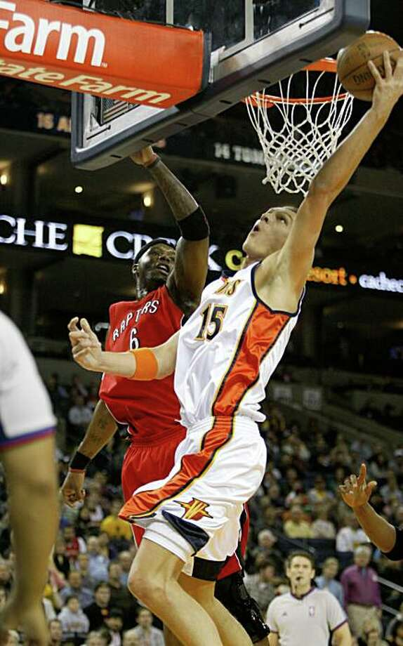 Golden State Warriors Andris Biedrins (15) goes up for a shot in the 1st quarter against Toronto Raptors Jermaine O'Neal (6) during a NBA game against the Toronto Raptors at Oracle Arena in Oakland, Calif., on Monday, December 29, 2008. Photo: Michael Maloney, The Chronicle