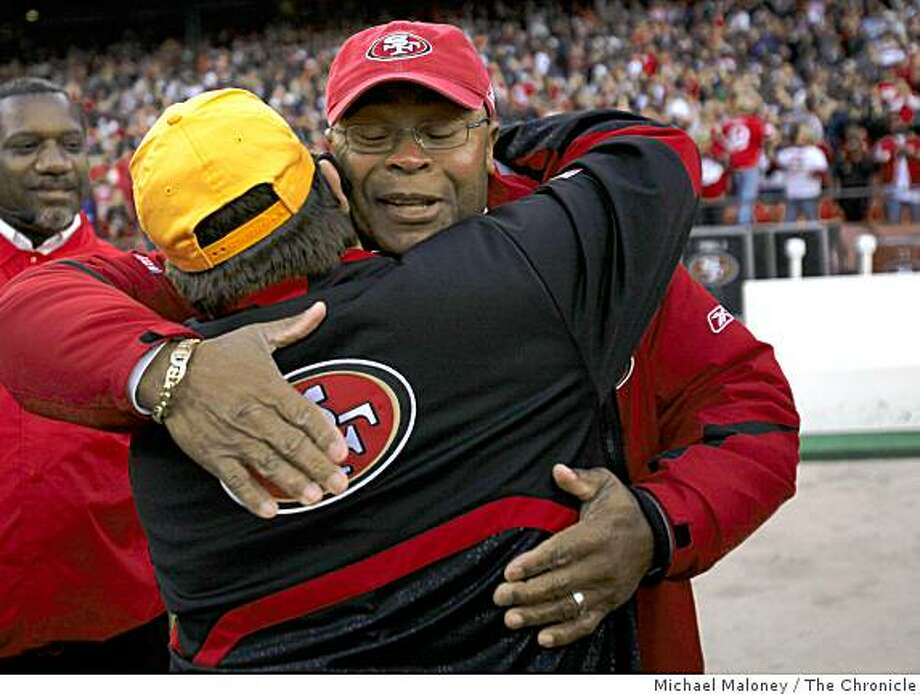 San Francisco 49ers head coach Mike Singletary (facing camera) is congratulated by staff after winning 27-24 during a game hosted by the 49ers at Candlestick Park on Sunday, December 28, 2008. Photo: Michael Maloney, The Chronicle
