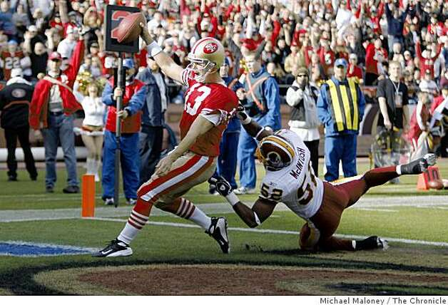 San Francisco 49ers quarterback Shaun Hill (13) scores a td in the 1st quarter with Washington Redskins Rocky McIntosh (52) covering  in a game hosted by the 49ers at Candlestick Park on Sunday, December 28, 2008. Photo: Michael Maloney, The Chronicle