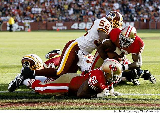 San Francisco 49ers DeShaun Foster (29) crosses the goal line for a 3rd quarter TD. Tackling him is Washington Redskins Rocky McIntosh (52) in a game hosted by the 49ers at Candlestick Park on Sunday, December 28, 2008. The 49ers won 27-24. Photo: Michael Maloney, The Chronicle