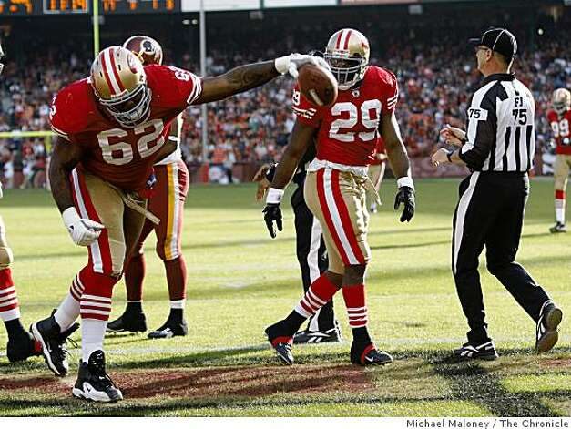 San Francisco 49ers Chilo Rachal (62) spikes the ball for DeShaun Foster (29) after Foster scored a TD in the 3rd quarter of a game hosted by the 49ers at Candlestick Park on Sunday, December 28, 2008. The 49ers won 27-24. Photo: Michael Maloney, The Chronicle