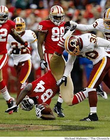 San Francisco 49ers Josh Morgan (84) is upended on a 3rd quarter run of a game hosted by the 49ers at Candlestick Park on Sunday, December 28, 2008. The 49ers won 27-24. Photo: Michael Maloney, The Chronicle