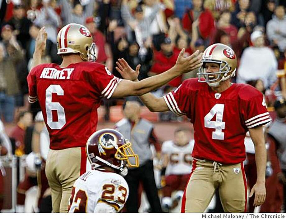 San Francisco 49ers kicker Joe Nedney (6) and holder Andy Lee (4) celebrate the game winning kick with seconds left of a game hosted by the 49ers at Candlestick Park on Sunday, December 28, 2008. The 49ers won 27-24. Photo: Michael Maloney, The Chronicle