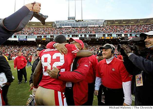 San Francisco 49ers head coach Mike Singletary (right) and  Bryant Johnson (82) meet after winning 27-24 during a game hosted by the 49ers at Candlestick Park on Sunday, December 28, 2008. Photo: Michael Maloney, The Chronicle