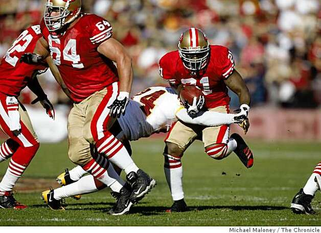 San Francisco 49ers Frank Gore (21) is taken down by Washington Redskins Shawn Springs (24) in the 1st quarter of a game hosted by the 49ers at Candlestick Park on Sunday, December 28, 2008. Photo: Michael Maloney, The Chronicle
