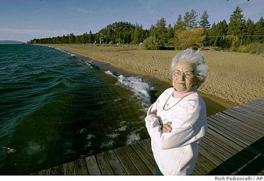 Norma Thayer is seen on a dock near her home at the Tahoe Shores Mobile Home Park  in Stateline, Nev., Wednesday, Oct. 8, 2008. Thayer is one of about 30 residents of the park who are about to be forced out to make way for a new upscale development. (AP Photo/Rich Pedroncelli) Photo: Rich Pedroncelli, AP