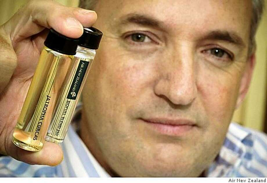 Captain David Morgan holds capsules of jatropha oil and Air New Zealand�s biofuel blend NZ-J50. Photo: Air New Zealand, Courtesy To The Chronicle