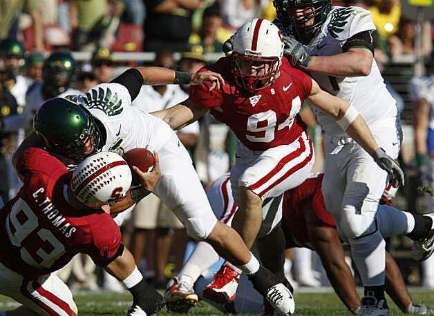 Stanford's Chase Thomas and Thomas Keiser sack Oregon quarterback Nate Costa in the first half. Photo: Lance Iversen, The Chronicle